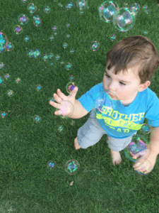 using bubbles to teach toddler air movement